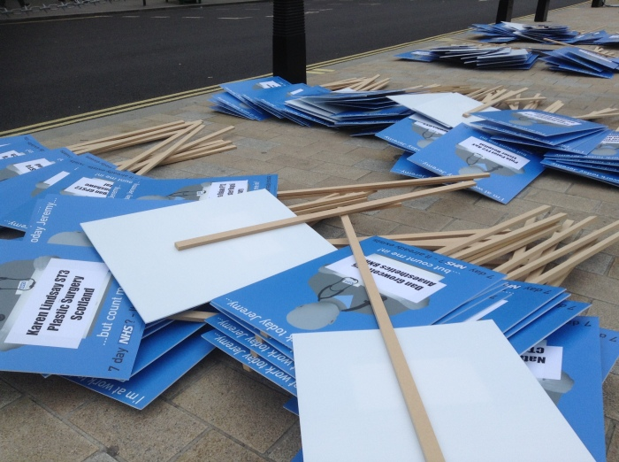 Each placard carried the name of a doctor who would be protesting but was working.